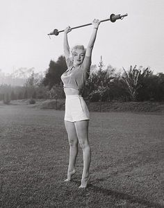 """""""Marilyn Workin' It"""" - Iconic Photograph posters and prints available at Barewalls.com"""