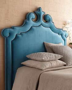 Moroccan-inspired upholstered headboard. Love the curves and color.