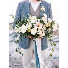 There's nothing like a dapper #groom holding a stunning #weddingbouquet! #bouquet #beachwedding #weddingphotography | Photography: @jenwojcik | Floral Design: @plentyofpetals | Groom's Attire: @CrowThief | Event Design & Coordination: @tolalune | Wardrobe Styling: @thorneartistry | Ribbon: @bellameribbon