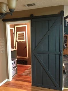 DIY Sliding Barn Door This is so going downstairs when Dave starts remodeling