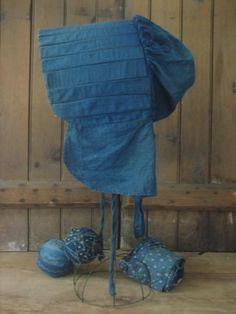 primitive blue sunbonnet, my Mother made me one like this to wear in the Summer because I had red hair and freckles so sunburnt easily in the hot Australian Summer sun