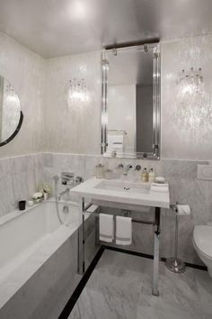 Gray and White Bathrooms   The white and gray marbling of this bathroom marks the minimal ...