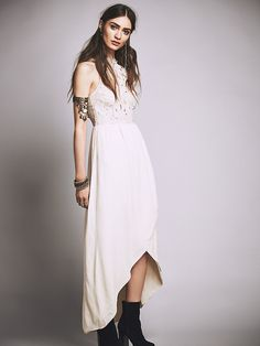 Melody Maxi Dress | Equal parts ethereal and romantic, this maxi dress features a floral lace applique bodice with delicate scalloped trim. Sweeping high-low skirt with sweet surplice detail makes for a dramatic silhouette. Exposed back with button closure at the top and hidden zip with hook-and-eye closure for an effortless fit. Fully lined.