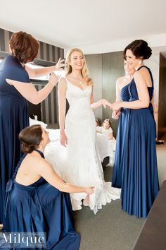 ROSEMARY'S BRIDESMAIDS LOOKING CHIC IN THE GODDESS BY NATURE SIGNATURE MULTIWAY BALLGOWN DRESS IN NAUTICAL NAVY COLOUR.