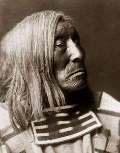 Here for your enjoyment is an exciting photograph of Lone Tree, an Old Crow Indian Brave (Apsaroke). It was made in 1908 by Edward S. Curtis.    The photo illustrates this old gentleman in an almost profile portrait.    We have compiled this collection of photos mainly to serve as a vital educational resource. Contact curator@old-picture.com.
