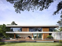 Pleasurable Eco Friendly House Design Glass Sliding Door Glass Windows Two Level House Big Tree Green Grass On Garden Wood Deck Frames Swimming Pool Brown Sofa Living Room Outstanding Architecture Singapore Residence Design Ideas