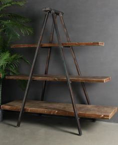 A fabulous large Industrial bookcase with Tripod of metal construction will look fabulous in your home with any style decor.  An impactful decorator piece with