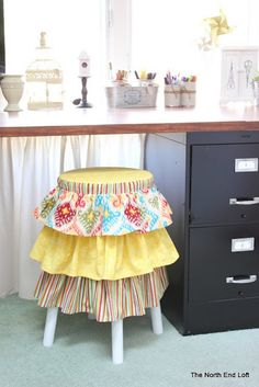 Ruffled Slipcover Tutorial - for a stool. I want some of these in my house! Easy step by step instructions. Nice way to upcycle some stools that you found at a thrift store or gargage sale. {Home Decor Idea} {DIY craft and sewing project}