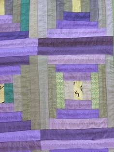 Courthouse steps quilt from Little Island Quilting.  Love the colors and the quilting.