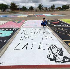 High School Seniors paint their own parking spaces.