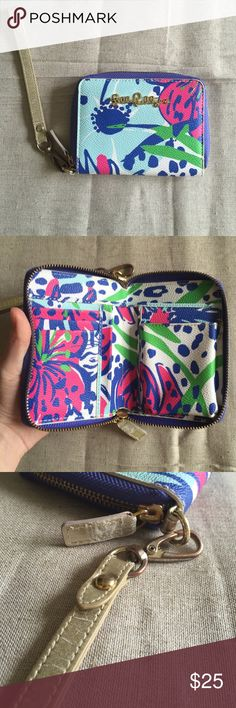 Lilly Pulitzer wristlet/wallet This cute wallet/ wristlet has very vibrant colors. Although the metal, zipper, and wristlet show wear, the actual body is in great condition! Metal color is faded, wristlet strap and zipper gold color appear cracked / faded as pictured. Normally an expensive wristlet but you can get it for very cheap right here! Lilly Pulitzer Bags Clutches & Wristlets