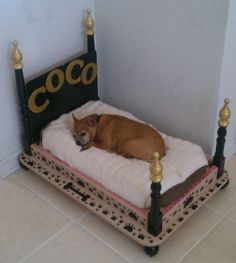 Dog bed made from an old end table.