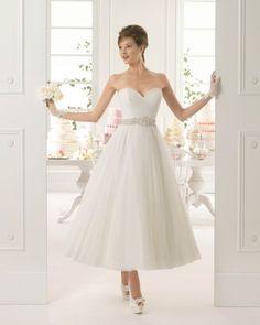 Vestidos de novia midi: La propuesta retro que le dará estilo a tu look Image: 18