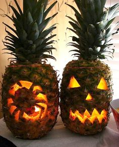 Pineapple Jack-O-Lantern with Spooky Faces. Great for a Warm Weather or Tropical Beach Halloween: http://www.completely-coastal.com/2014/10/jack-o-lantern-pineapple-carving-for-Halloween.html