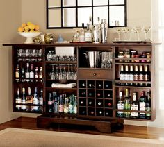 How to Stock a Bar. Have you ever wanted to have your own bar? Creating a bar in your home is fun and easy! To do this, you will need to stock the bar with the necessary ingredients, tools, and find the perfect space for it. Find a good. Home Bar Cabinet, Liquor Cabinet, Cabinet Storage, Alcohol Cabinet, Armoire Bar, Wine Storage, Cabinet Ideas, Bar Sala, Bar Shelves