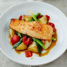Salmon with potatoes and spring onions. For the full recipe and more click the picture or visit RedOnline.co.uk