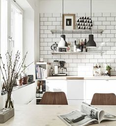 I used a larger version of this light and it looks stunning. This shared kitchen/dining space is warm and inviting via @MyDomaine