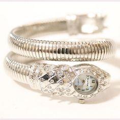 $17.99 (Buy here: https://alitems.com/g/1e8d114494ebda23ff8b16525dc3e8/?i=5&ulp=https%3A%2F%2Fwww.aliexpress.com%2Fitem%2FLuxury-Women-Watches-Lady-Snake-Dress-Watch-Stainless-Steel-Rhinestone-Bracelet-Wristwatch-Female-Crystal-Bangle-Watches%2F32577596337.html ) Free shipping Luxury Women Watches Lady Snake Dress Watch Stainless Steel Rhinestone Bracelet Wristwatch Female Crystal Bangle for just $17.99