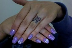 Cute bow tattoo