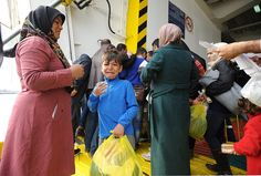 But amid chaotic scenes yesterday Greek officials scrambled to evacuate migrants held in i...