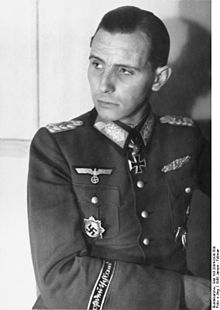 """Otto-Ernst Remer (18 August 1912 – 4 October 1997) was a German Wehrmacht officer who played a decisive role in stopping the 1944 20 July Plot against Adolf Hitler. During the war he was wounded nine times in combat. After the war he co-founded the Sozialistische Reichspartei (SRP) and advanced Holocaust denial. He is considered the """"Godfather"""" of the post-war Nazi underground."""