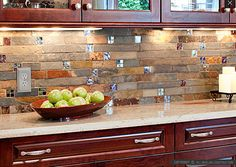 Use slabs of slate tile as your backsplash that differ in color but still complement one another. You can make it even better by adding pieces of glass tile between the slabs
