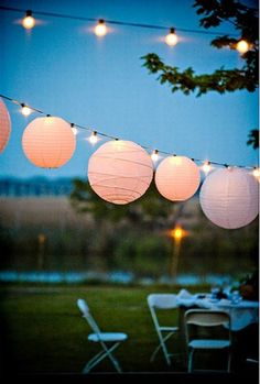 Garden party lights - Even though it's inside, maybe we could find some of these in blue, yellow and/or gold to hang from the ceiling in the reception