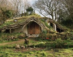 """Nicknamed """"The Hobbit House"""", this fairytale–like cottage is located in a forest in Wales. Built with maximum regard for the environment, the house gives its dwellers a unique opportunity to live literally in the heart of nature. Casa Dos Hobbits, Beautiful Homes, Beautiful Places, Fairytale Cottage, Underground Homes, Underground Living, Unusual Homes, Earth Homes, Earthship"""