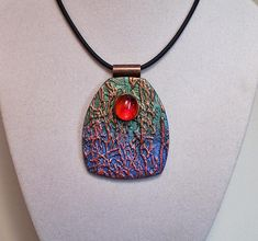 Texture pendant in blue gree red gold with glass gem accent polymer clay | Flickr