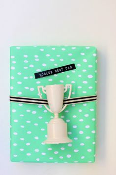 father's day gift wrap idea - Would be cute with the tape on the trophy too!