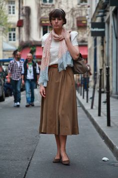 Paris Who: Madeline What: student Wear: Maje tope and skirt   Read more: Global Street Style - Discover More Street Style  Follow us: @ElleMagazine on Twitter | ellemagazine on Facebook  Visit us at ELLE.com