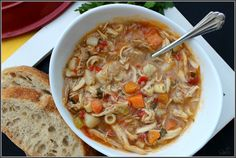 Authentic Sicilian Chicken Soup with a peppery broth, fresh vegetables and tender most chicken.