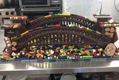 1.2 meter long Sydney harbour bridge made out of chocolate and @darrelllea mixture including liquorice bullets peanut brittle rocklea road grape strawberry and chocolate twists no-peeps tall sorts nougat eggs #CreatewithDl #Aussielollycreationcompetition #katherinesabbath #geoffreymichaelpatissier #darrelllea #chocolate by geoffrey_michael_patissier http://ift.tt/1NRMbNv