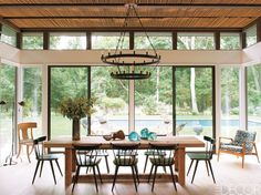 Prominent DJ Victor Calderone and his wife Athena envisioned the ideal summer getaway when they discovered a neglected 1960s ranch house in Amagansett, New York. Click through for more summer house design ideas.