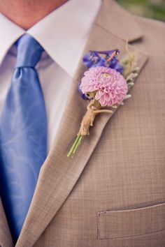 Khaki, white and light blue. Don't love his boutonnière though...