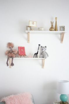 Are those rose gold shelf brackets we see?