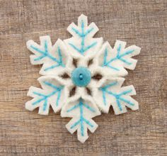 https://flic.kr/p/8Tz9aa | Snowflake Pin | Pink and white  and turquoise and white for Christmas has been hot on Etsy so I made a couple of snowflake pins in those colors. I need to get some soft minty green yarn because that's been showing up in some beautiful treasuries too.