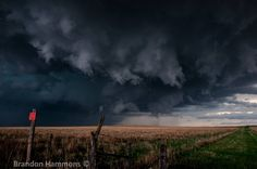 Tornado warned supercell, near Salina, KS. The clouds at this point, were exhibiting some very wild motion, and rotation. Also of note, are the while hail streaks that can be seen in this shot, as this storm would soon drop tennis ball sized hail in Salina. (4/24/16)