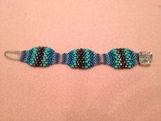 I am so excited about how this bracelet turned out.  Thanks for sharing the tutorial Feathered Fibers!