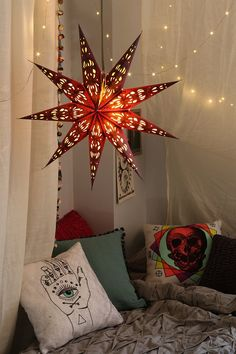 Magical Thinking Star Paper Lantern from Urban Outfitters. I love those pillows too.