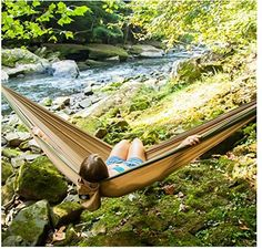 Legit Camping - Double Hammock - Lightweight Parachute Portable Hammocks for Hiking , Travel , Backpacking , Beach , Yard . Gear Includes Nylon Straps & Steel Carabiners  QUALITY YOU CAN CRASH ON: With this Double Camping Hammock from Legit Camping, you'll have everything you need to relax in complete comfort on your next camping or hiking trip. Heading to the beach or taking in a festival? Don't leave home without your parachute hammock. With its lightweight, spacious design and 400-pound…