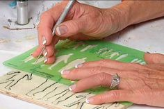 Using a stencil-scribing the image on the wax and building up the surface with medium. This image is from the workshop Encaustic With a Textile Sensibility by Daniella Woolf, available through Galli Publishing.