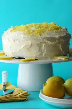Ultra-lemony 2-layer vegan lemon cake with a velvety lemon buttercream frosting! This delicious vegan cake is perfectly moist and spongey and will make all your lemon cake dreams come true! | lovingitvegan.com