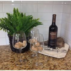 Wine decor- little dinos in the glasses?