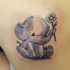 5 Best Elephant Tattoos – Meanings, Ideas and Designs 5 - elephant holding a sunflower tattoo Baby Elephant Tattoo, Elephant Tattoo Meaning, Elephant Tattoo Design, Elephant Design, Elephant Baby, Baby Tattoos, Flower Tattoos, Body Art Tattoos, Sleeve Tattoos