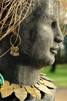 for realz? Earrings on a planter head??? would not have thought of this, adds a splash of color