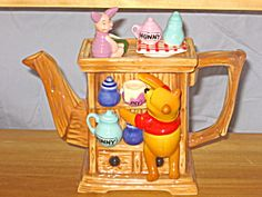 This is a cute teapot. It was made by Cardew in England. It is a limited edition #3948 of 5,000. Pooh is climbing to reach the honey pot. It is 7 inches high, 8 inches wide and 4 inches deep. It is mint in its original box.(Additional charge of $16.50 for shipping/handling.)