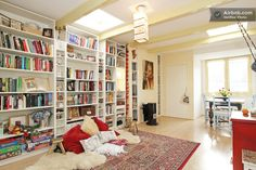 The floor to ceiling bookshelves. The floor pillow cozy area. The natural light. !!!!