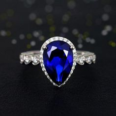 2015 New Affordable 8x12mm Pear Cut Blue Sappphire Sterling Silver Engagement Ring for Women   http://www.jewelsin.com/p-2015-new-affordable-8x12mm-pear-cut-blue-sappphire-sterling-silver-engagement-ring-for-women-1245