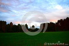Photo about Beautiful sky with nice colors, green field and forest in the background. Image of norwigian, norway, agriculture - 121747885